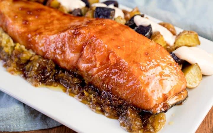 Glazed teriyaki salmon plated with spicy roast potatoes