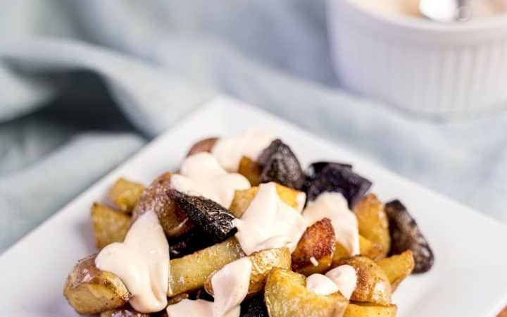 Spicy roast potatoes on a plate with peri peri mayonnaise